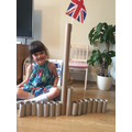 Sophie in Frog's Maya Lin inspired sculpture of Buckingham Palace