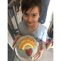 Mason and a his wonderful rainbow cake