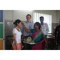 Miss Duong receiving a Bindi from the teachers.