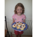 Poppy in Tadpole class with her delicious cupcakes