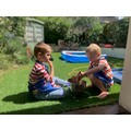 Ethan and Harrison in Tadpole helping to clean