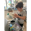 Charlie in Frog class making scones