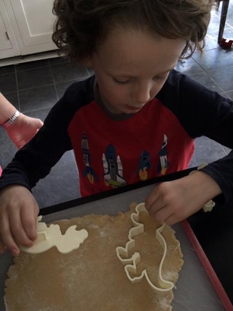 Dinosaur cookie cutting