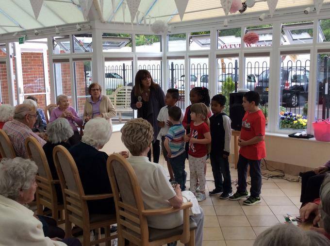 Entertaining the residents with an impromptu song.
