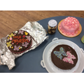 The children were very proud of their cakes.
