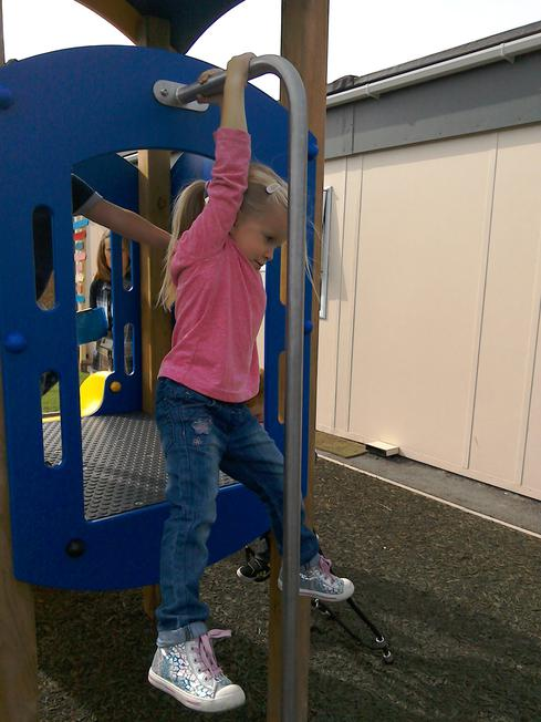 Hanging off the pole.