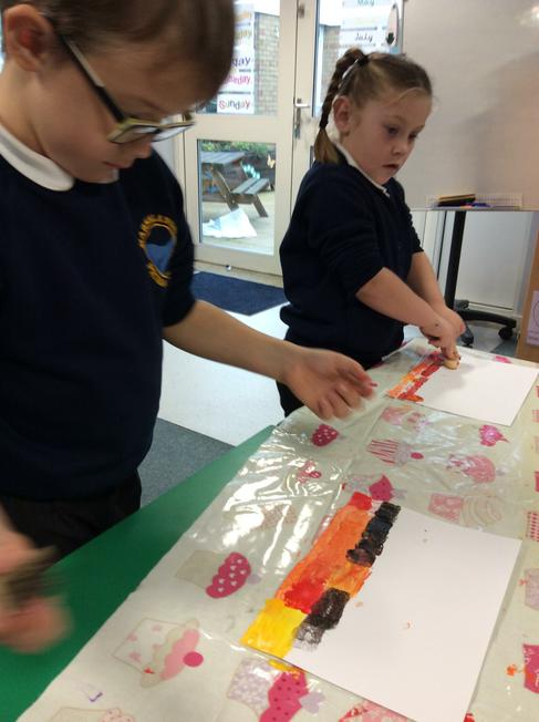 We used potato sticks to print our abstract design