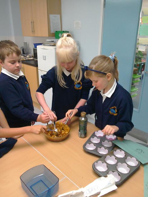 Yum! Making sticky cornflake buns!