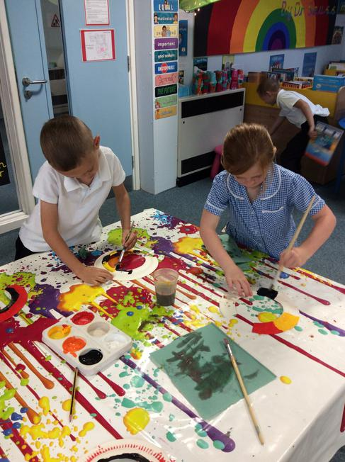 We painted the necklaces in the colours...