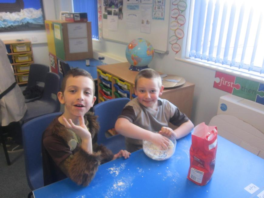 Adding the water to make our dough.