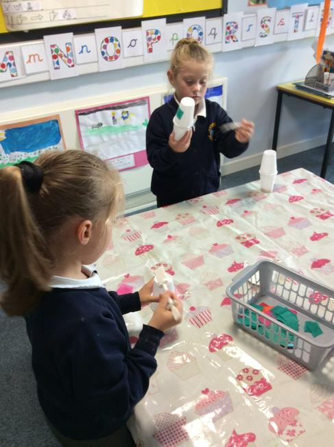 We made shakers using yoghurt pots and dried beans