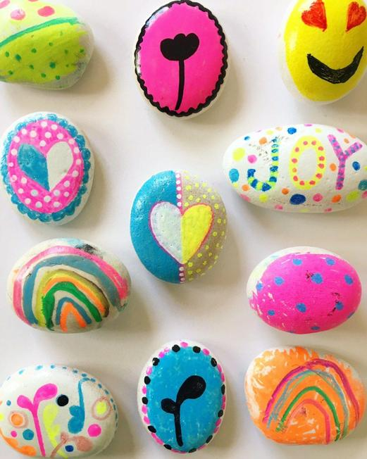 use paint or sharpies to paint on rocks