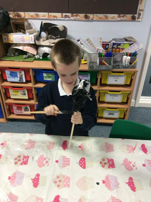 We made spears and axes with sticks and newspaper.