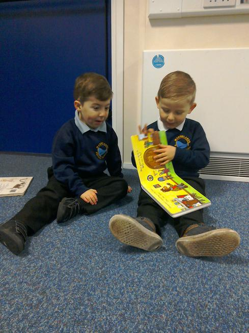 We like to look at books and tell stories.