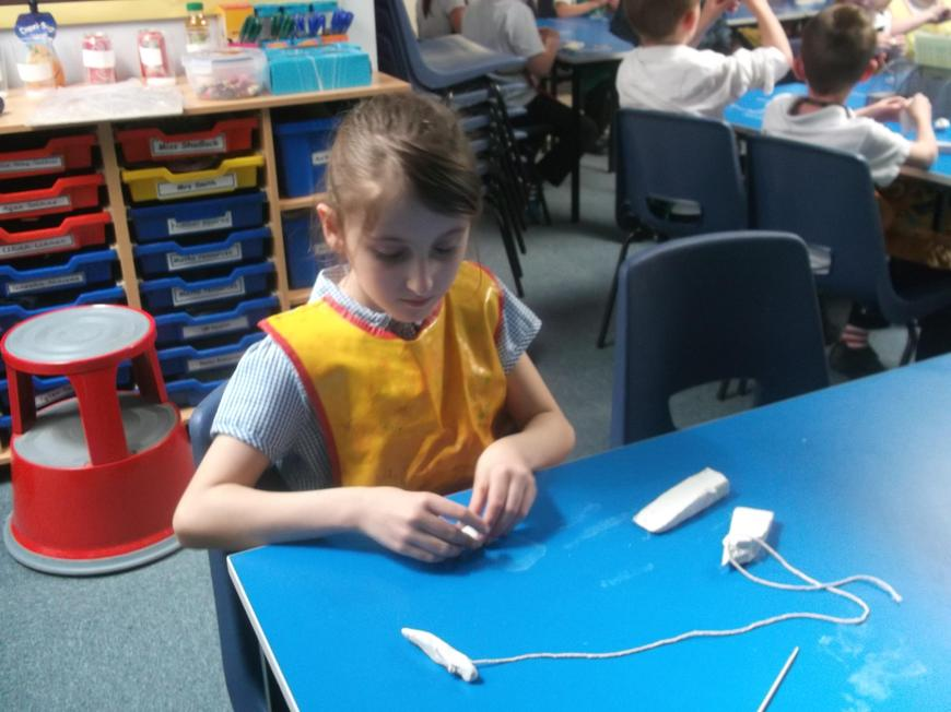 Making Stone Age necklaces