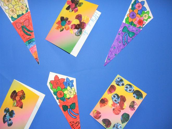 We designed and made cards and paper bouquets