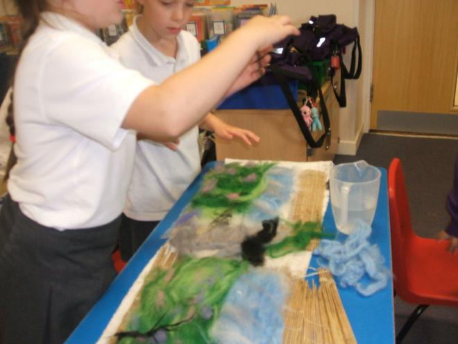 We added dyed wool on top to create land and sky