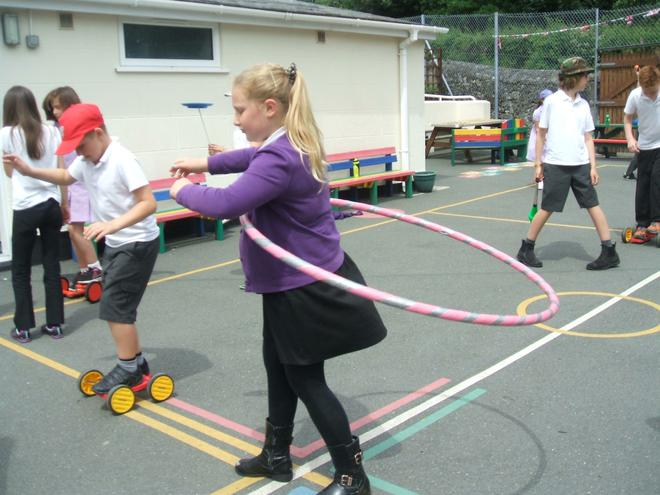 Learning how to hula hoop