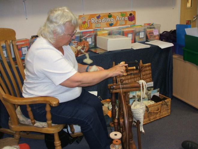 Mrs Hambly spins her own wool on a spinning wheel