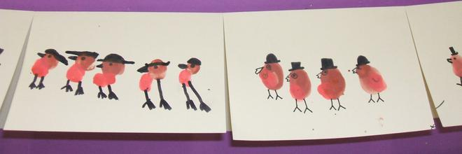 We printed robins with our fingers and thumbs