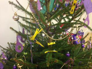 Every child put a decoration on the tree