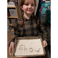 Alice practising words with the sound 'ow' (blow the snow) in them.