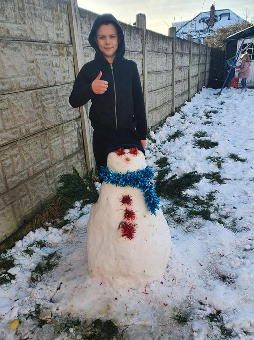 Lewis and his snowman.