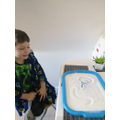 Luca practising words with set 1 sounds in.