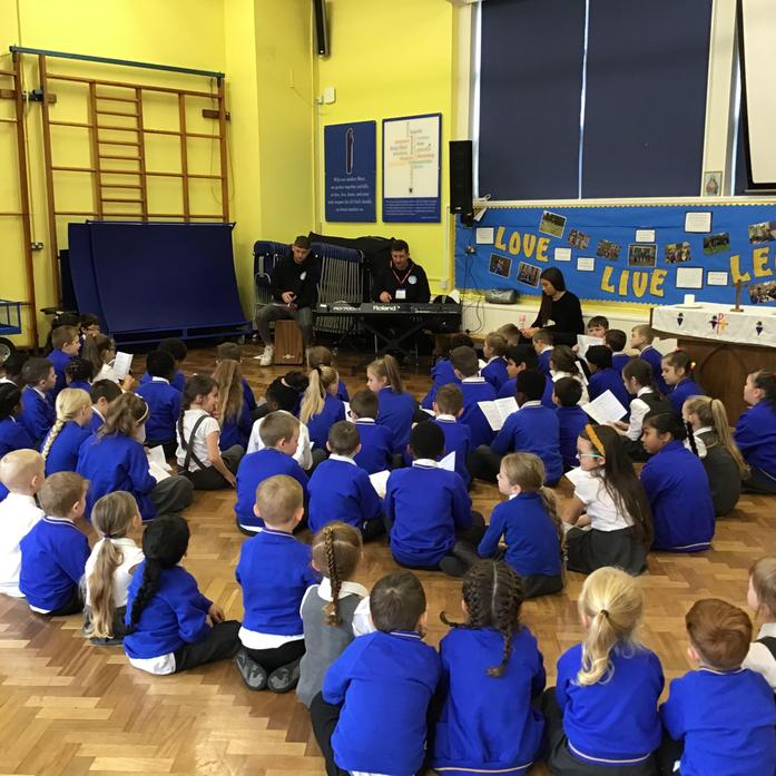 Song bug came in to teach us new songs for Mass