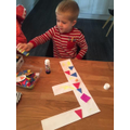 Frankie is decorating the letter F!