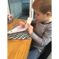 Frankie is practising his scissors skills!