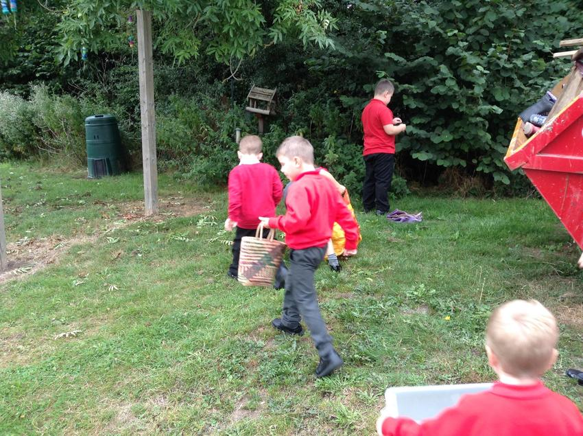 Collecting leaves and twigs for our small world tray