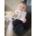 Igor is very pleased with his collage of the letter sound Jj.