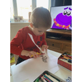 Frankie is practising his scissor skills.