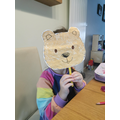 Isabel tries out her bear mask