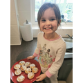 Isabel is very pleased with her fairy cakes!