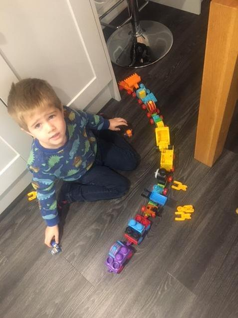 Frankie is having fun playing with his train's!