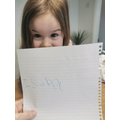 Isabel is pleased that she wrote her name by herself!