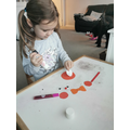 Isabel is having fun making her puppet!