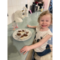 Gracie looks pleased with her Peppa pig cakes!