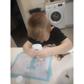 Igor is creating his letter sound i poster!