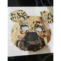 Sophie has been busy making her bear mask.