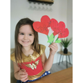 Isabel is happy with her flower hearts and she is going to give them to her family!