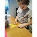 Isabel is decorating the letter sound K!