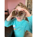 Gracie is checking that her binoculars work!