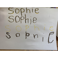 Sophie has been tracing and copying letters in her name