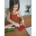 Isabel is putting her heart together to create a flower heart!