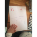 Frankie has been practising to write the letter sound Hh!