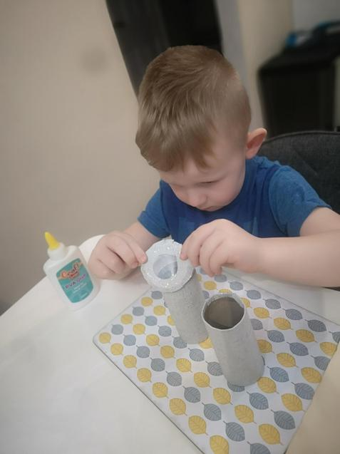 Igor is showing good concentration when making his binoculars!