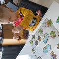 Joshua is carefully putting his jigsaw together.